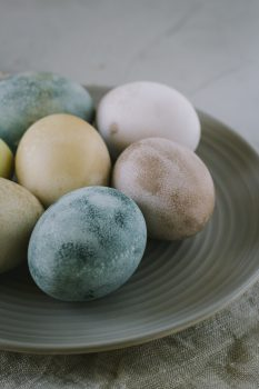 Assorted-color Easter eggs on a plate