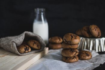 Baked cookies and a bottle of milk on a table