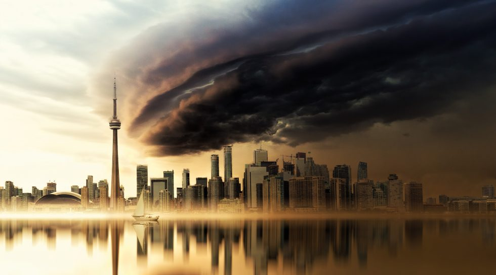 Black and brown clouds over a city by a bay