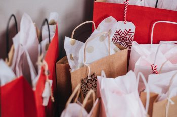 Christmas paper bags near a wall