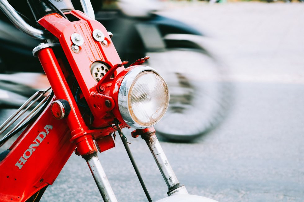 Close-up photo of a red motorcycle