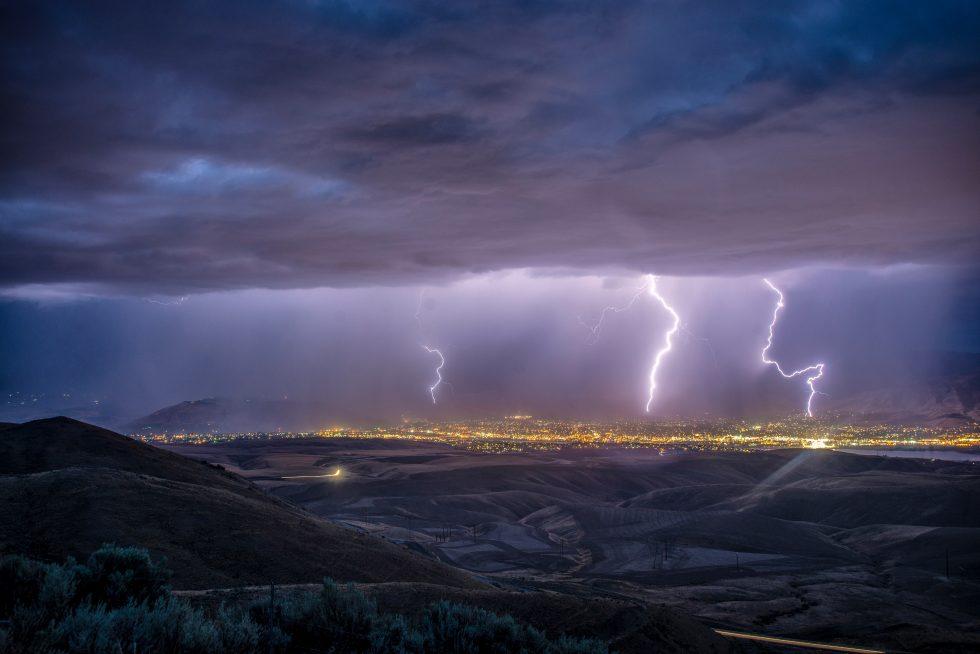 Lightning strikes over a city