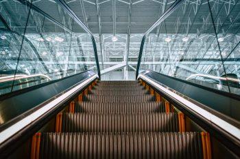 Low angle photo of an escalator