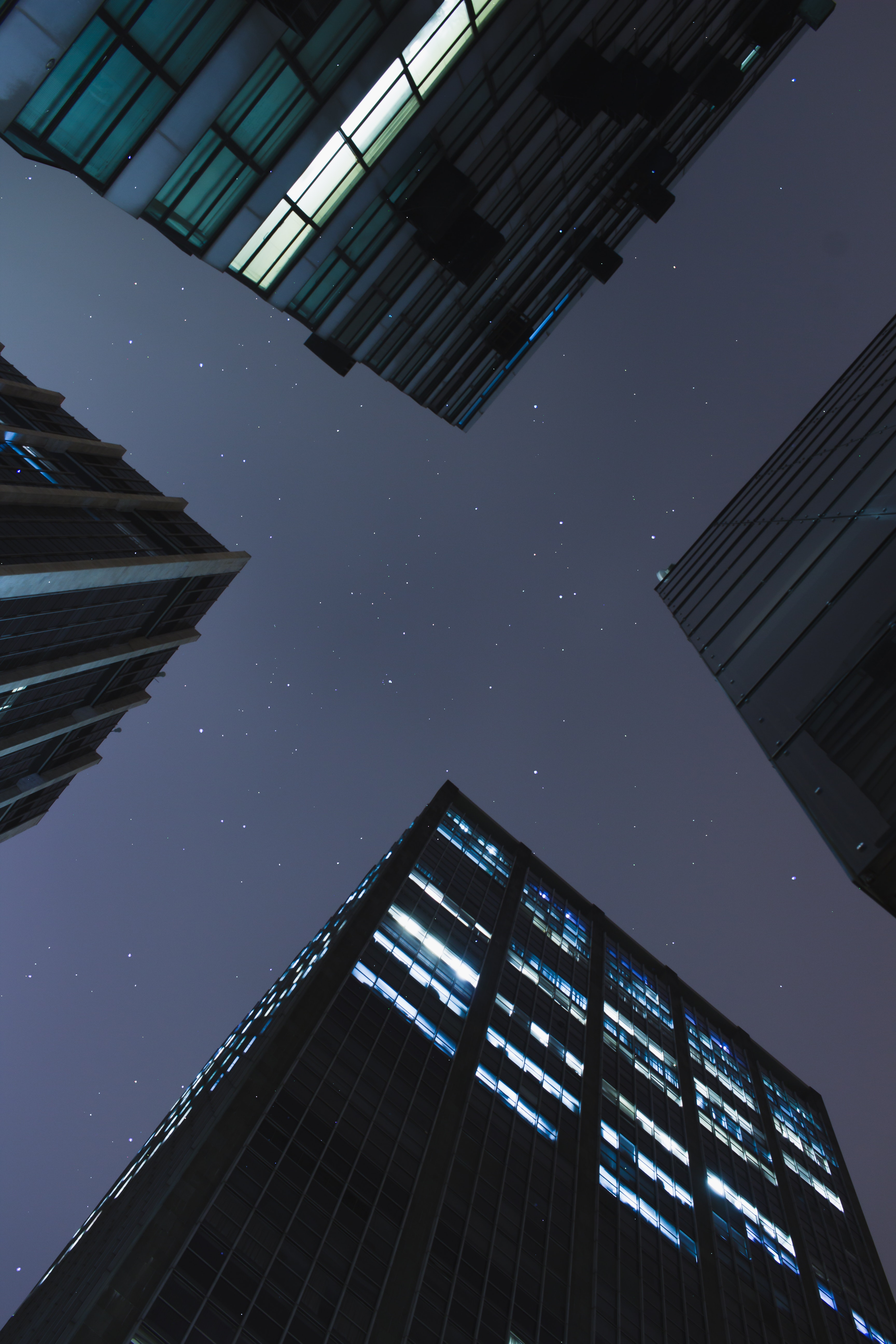 Low-angle photography of curtain wall buildings during the night