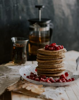 Pancakes and red berries on a plate