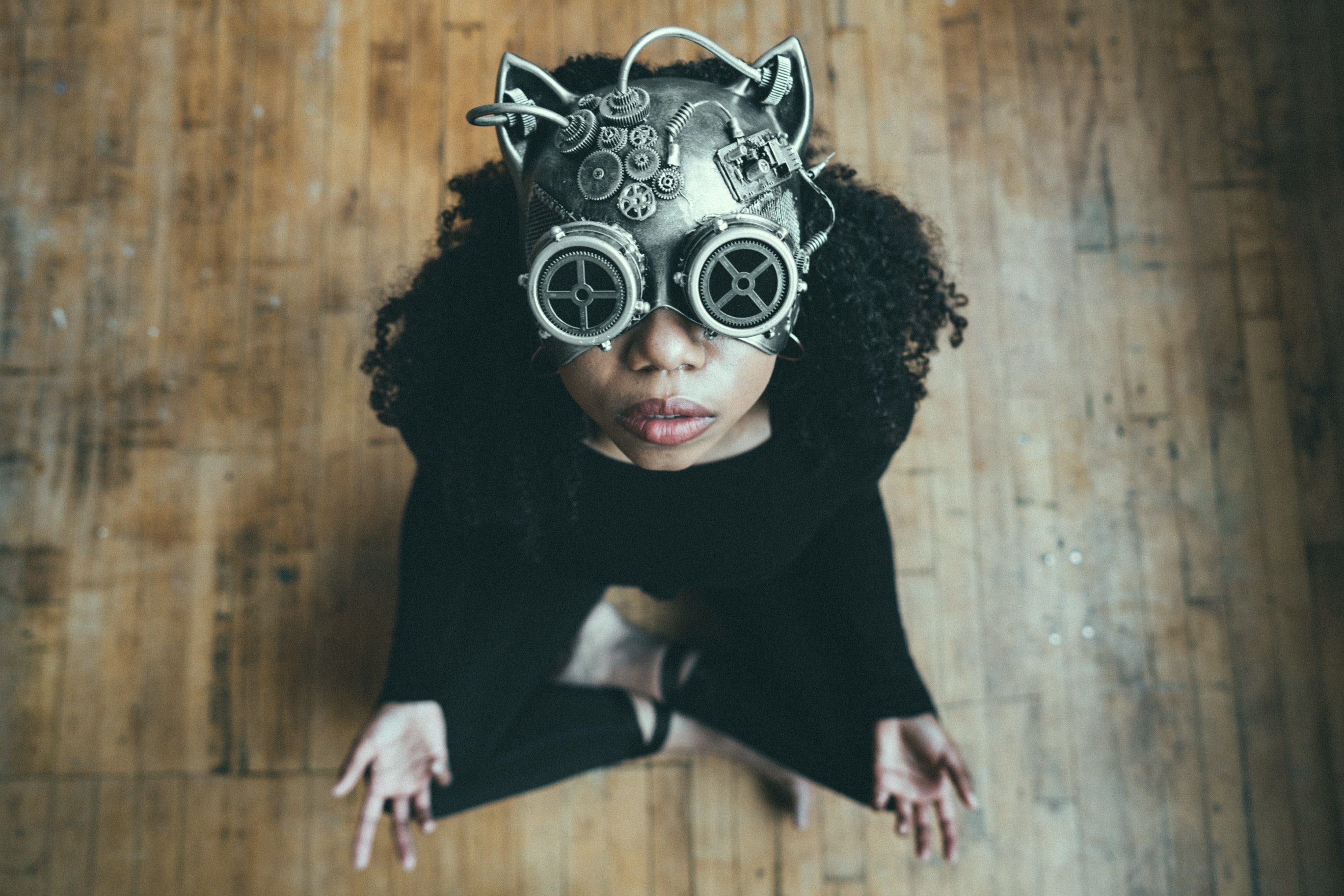 Photo of a sitting person wearing a Steampunk mask