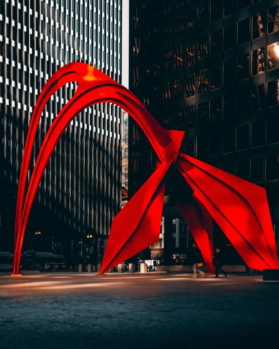 Selective-color photography of a red outdoor art