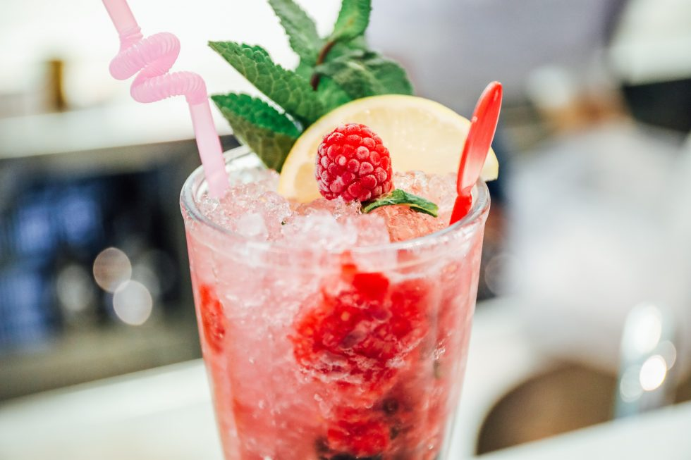 Selective focus photography of raspberry cocktail