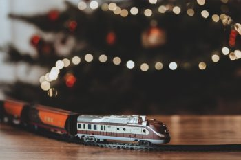 Shallow focus photography of a gray train plastic toy