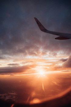 Sunset seen through an aircraft's window while on flight