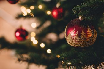 A Christmas tree with red baubles