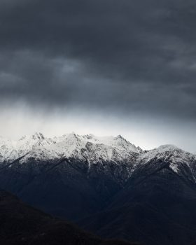 Photo of mountain Alps on a cloudy day