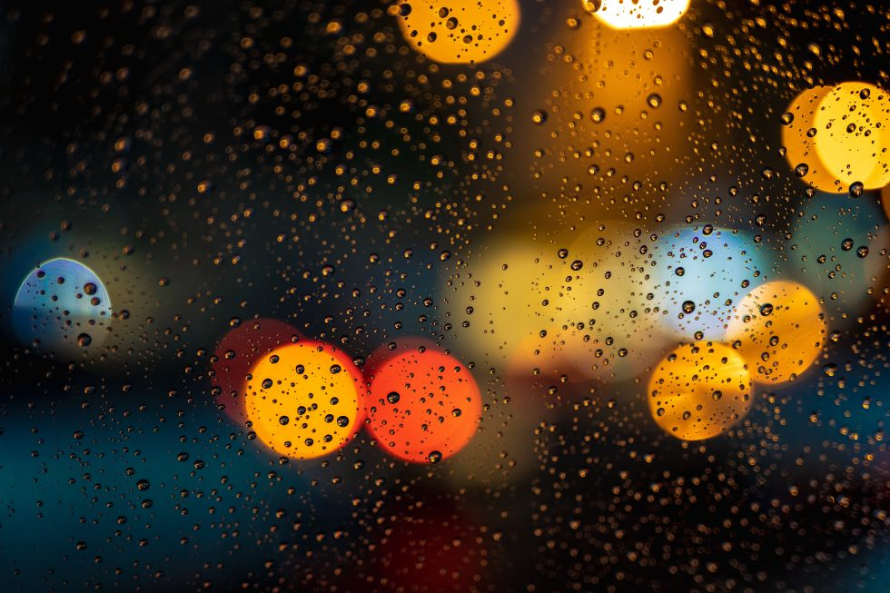 Bokeh photography of glass covered with drops