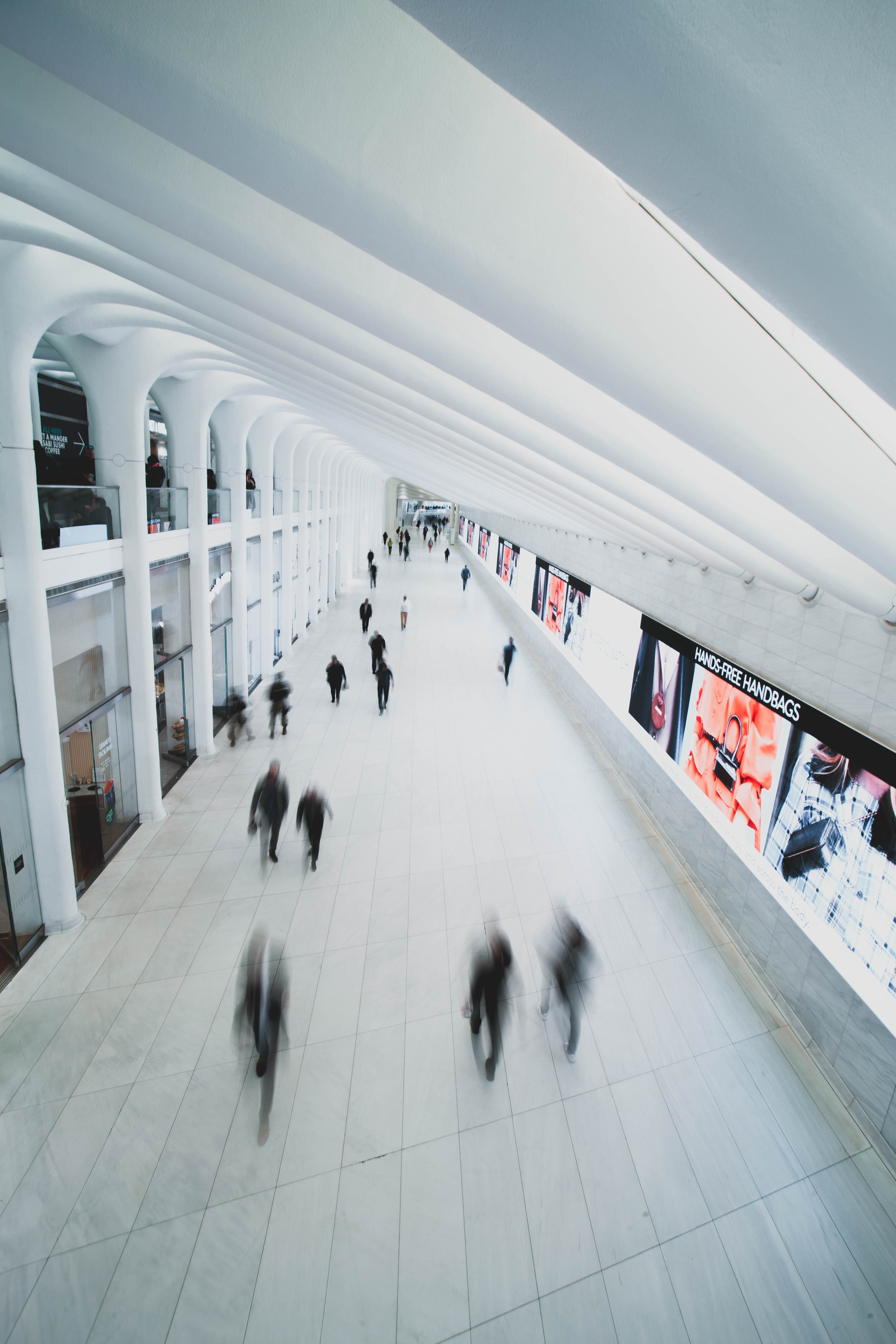 High-angle shot of people inside a white-painted hallway