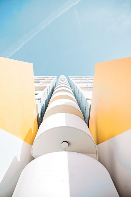 Low-angle photo of a white high-rise building