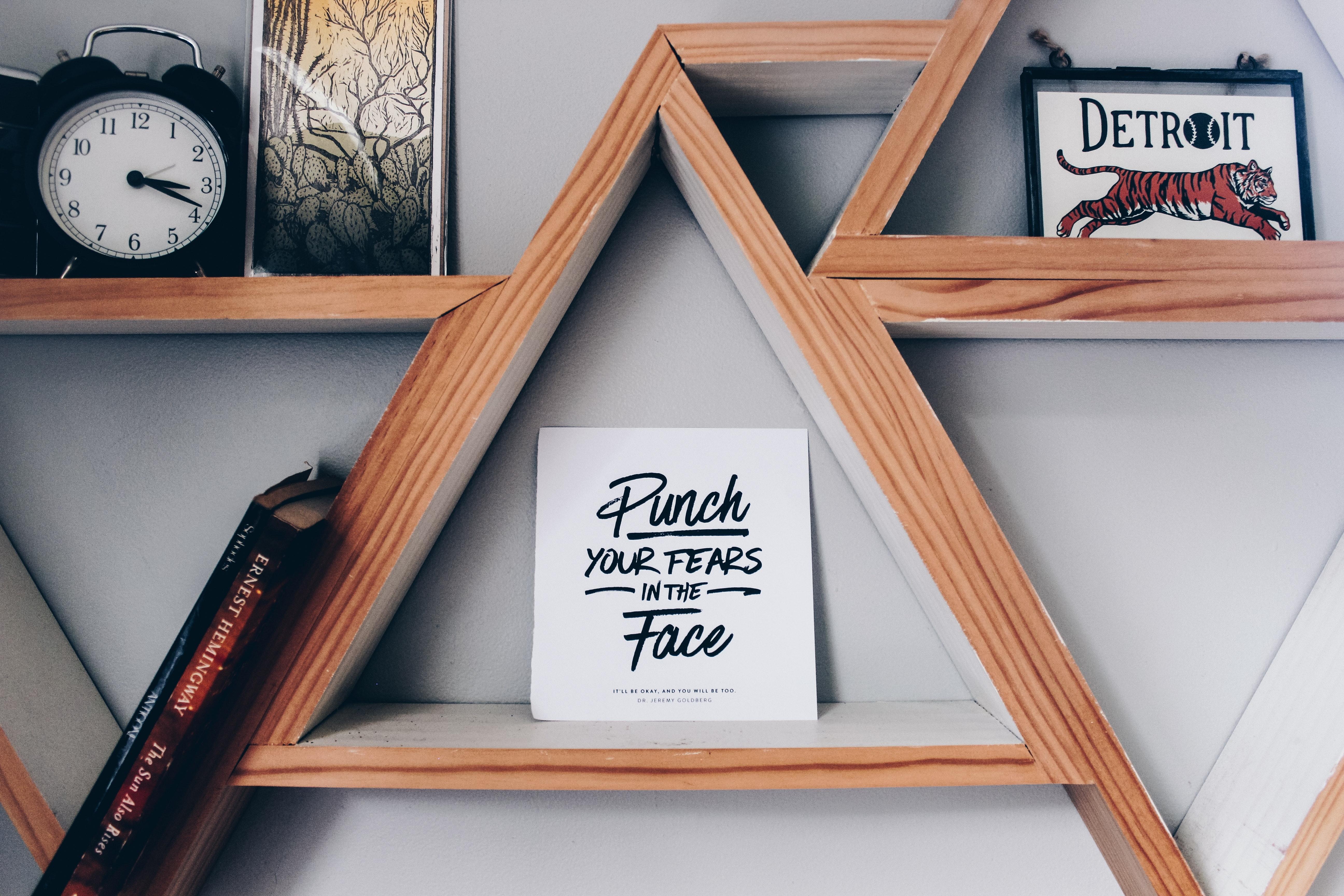 Photo of a card on a triangular shelf