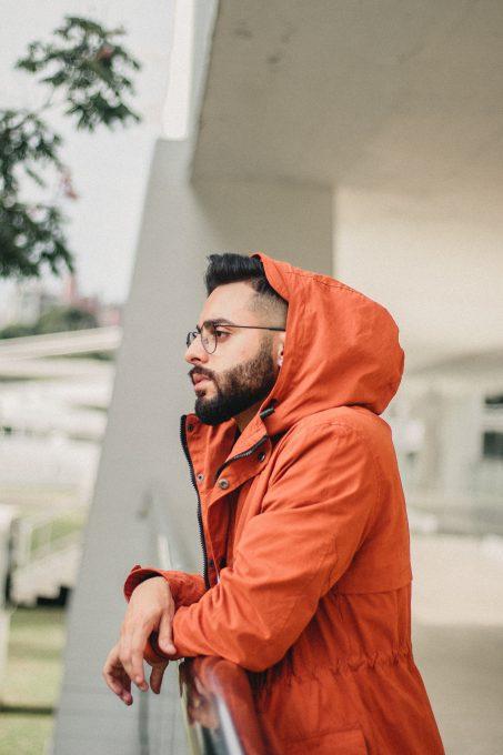 Photo of a man wearing an orange jacket