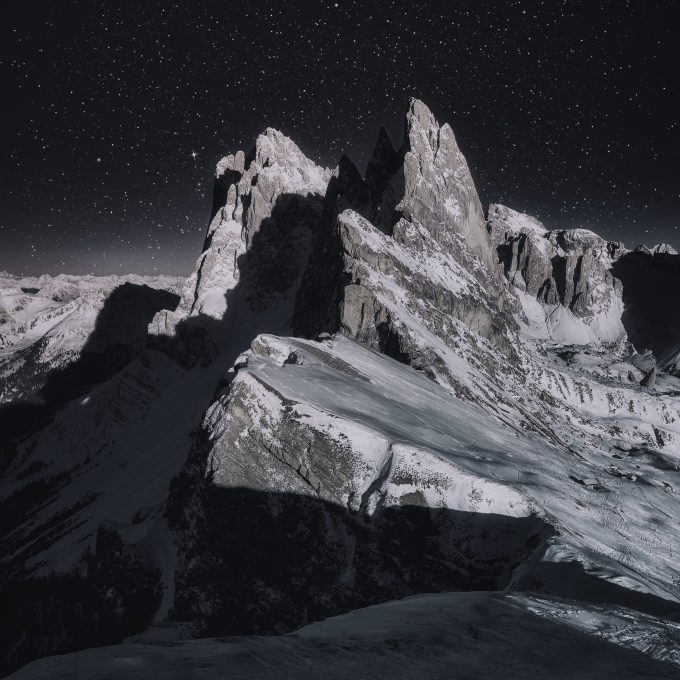 Photo of a snow-capped mountain during the night