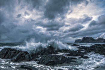 Photo of waves crashing on a gloomy day