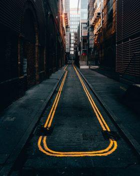 Photo of an empty alley in between buildings
