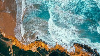 A bird's eye view of an ocean and shore