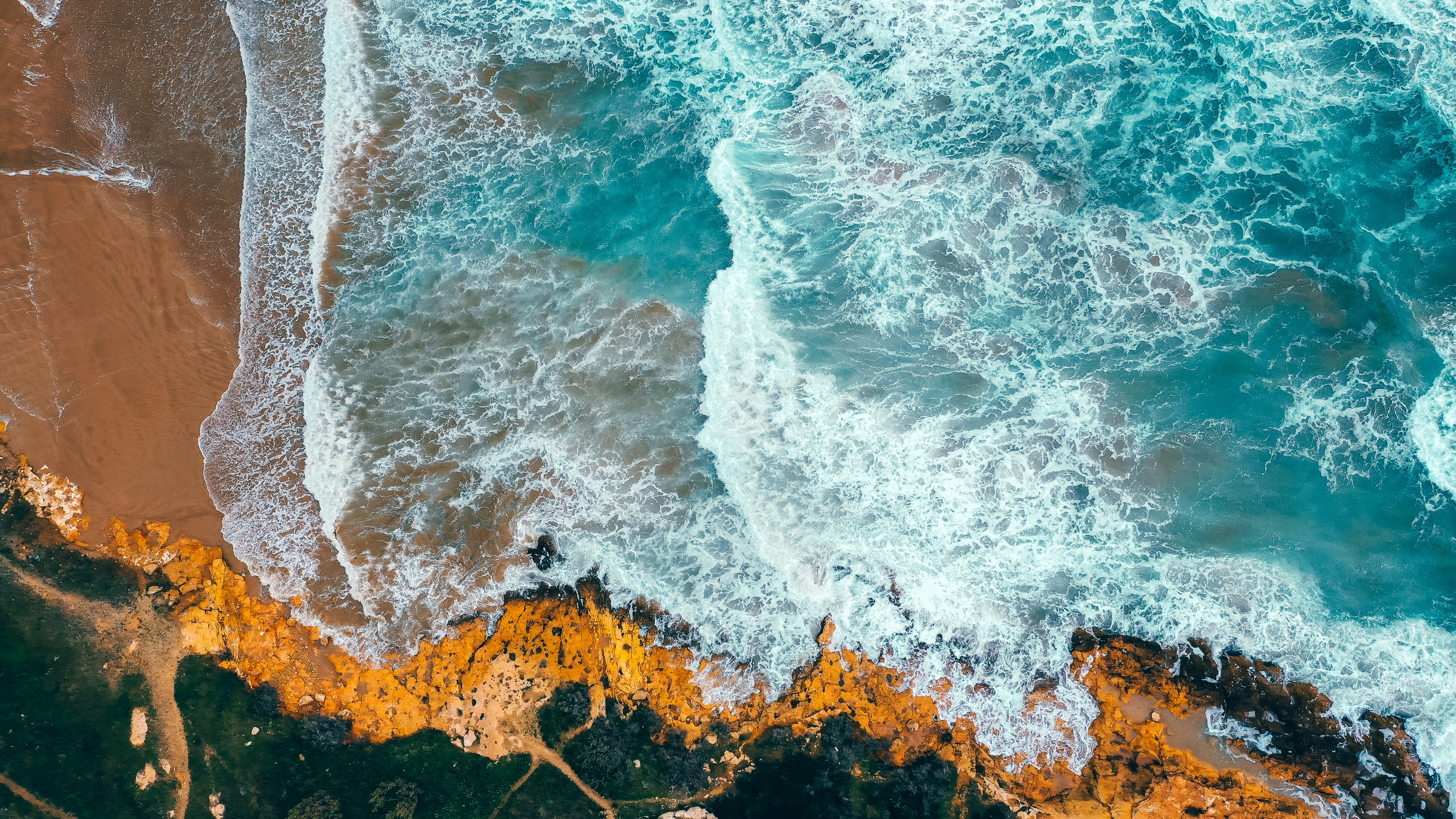 A bird's eye view of an ocean and shore