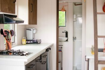 A kitchen counter with a view to the bathroom